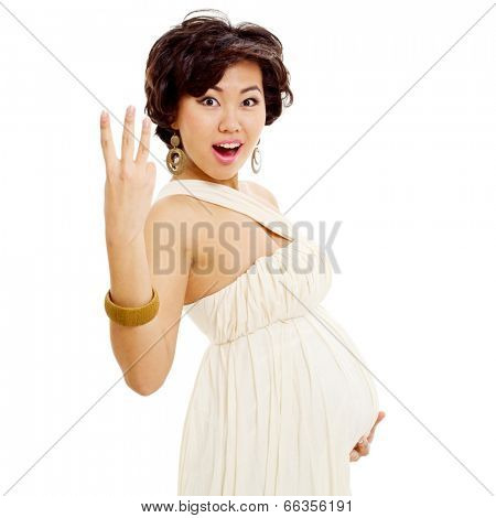 Amazed young asian woman holding her belly and showing three fingers, isolated on white background