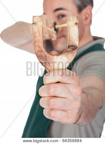 Close-up Of Hand Pulling Sling Shot