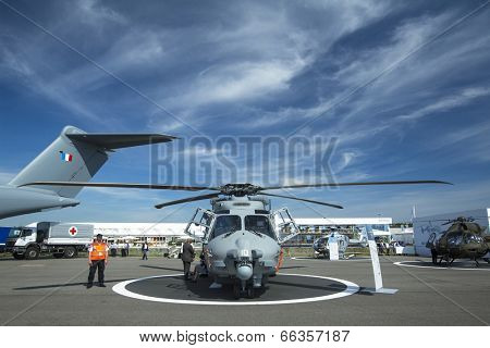 BERLIN, GERMANY - MAY 20, 2014: Multi-role military helicopter NH90 for Army use and the naval NATO Frigate Helicopter (NFH), demonstration during the Aerospace Exhibition ILA Berlin Air Show.