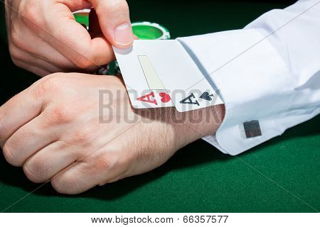 Human Hand With Cards In Sleeve