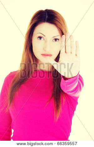 Hold on, Stop gesture showed by woman.