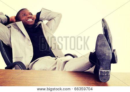 Happy successful businesman at the desk