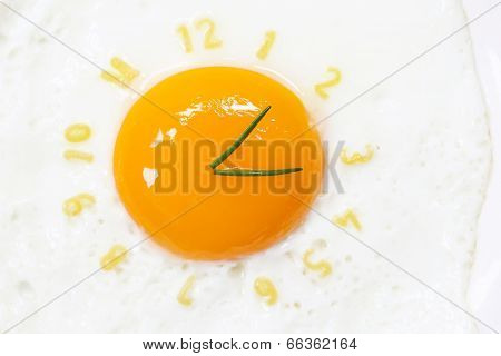 Fried egg sunny side up in form of a clock