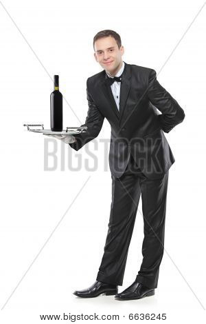 Young person holding a tray with a red wine on it