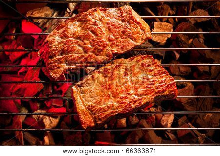 beef steak on the grill with