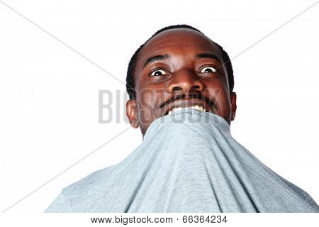 Portrait of crazy young african man biting his t-shirt over white background