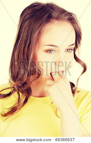 Woman putting her finger in her mouth to provoke vomiting