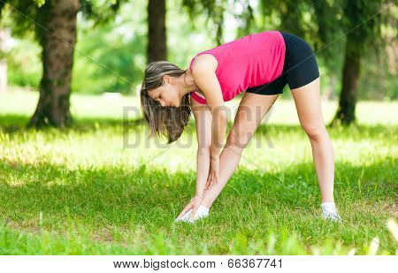 Young woman stretching outdor
