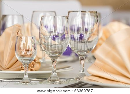 Served with a plate and glasses on the table