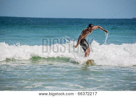 Surfer At Ilha Grande, Lopes Mendes Beach. Funny. Brazil Rio Do Janeiro.