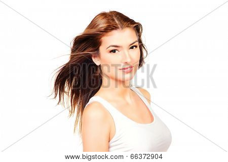 Beautiful smiling girl with fresh pure skin and beautiful hair in motion. Healthcare. Copy space. Isolated over white.