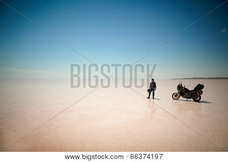 TUZ GOLU, TURKEY - AUGUST 25: Man with his bike at salt lake(Tuz Golu) on august 25, 2013, Turkey.