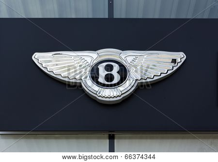 Dusseldorf, Germany - June 12, 2011: Bentley logo on the outside of car dealer's building. Bentley is a british luxury car manufacturer based in Crewe, England and belongs to Volkswagen AG.