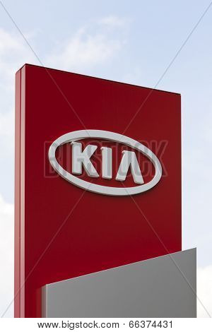 Dusseldorf, Germany - June 12, 2011: KIA logo at car dealer. KIA Motors, headquartered in Seoul, is South Korea's second largest automobile manufacturer and partly ownded by Hyundai.