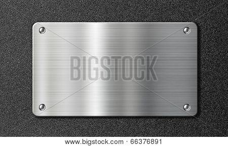 stainless steel metal plate over black texture