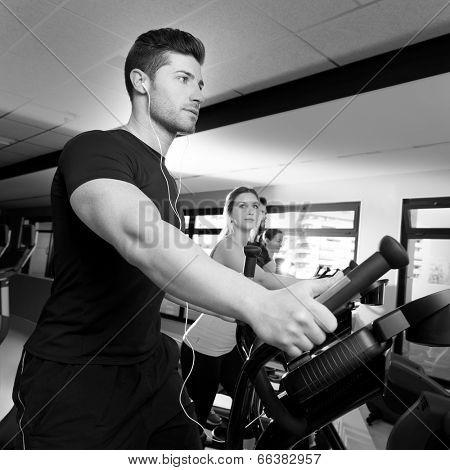 Aerobics elliptical walker trainer group at fitness gym workout