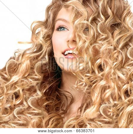 Beauty girl with blonde curly hair. Healthy and long permed Blond Wavy hair. Beautiful smiling young woman portrait. Beautiful face, natural make up