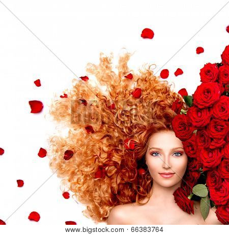 Beauty model woman with long curly red hair and beautiful red roses hairstyle with flowers and petals. Fashion girl with wavy healthy hair isolated on white background.