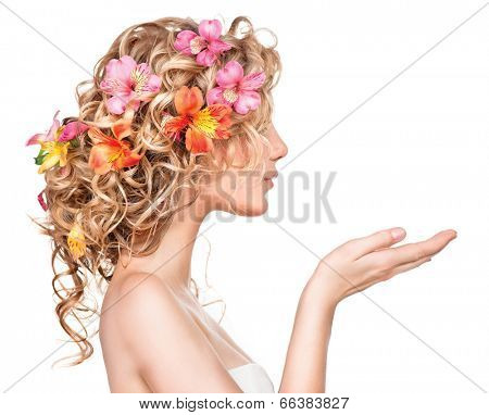 Beauty girl with flowers hairstyle and open hands isolated on white background. Fantasy girl portrait with colorful flowers. Summer fairy portrait. Long permed hair