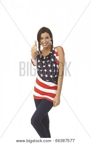 Happy American girl showing ok sign, smiling.