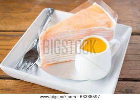 Homemade Orange Crepe Cake Serving On The Plate