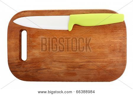 Kitchen knife and cutting board isolated on white