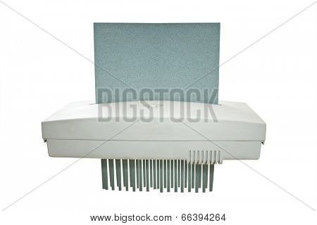 Paper shredder machine and recycled paper on white background