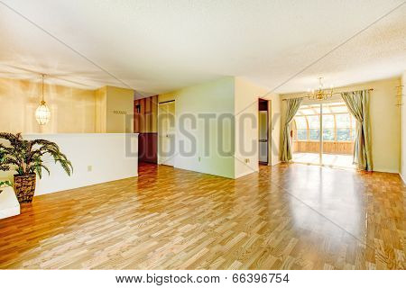 Empty Living Room With Walkout Screened Deck