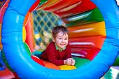 stock photo of playground  - happy kids playing on inflatable attraction playground