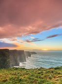 stock photo of cliffs moher  - Famous cliffs of Moher at sunset in Co. Clare Ireland Europe. Beautiful landscape as natural attraction.