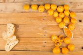 stock photo of loquat  - Still life with freshly picked loquats and homemade marmalade - JPG