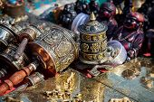 stock photo of nepali  - Prayer wheels and other souvenirs in the shop at Durbar square in Kathmandu Nepal