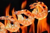 stock photo of flame-grilled  - Grilled shrimps on the flaming grill - JPG