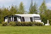 stock photo of caravan  - Caravan and camping tent on a camping site in Denmark.