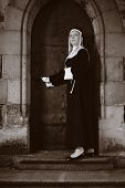 image of nun  - Nice girl posing like a nun walking by church in Prague for religion style photos. ** Note: Soft Focus at 100%, best at smaller sizes - JPG