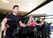 picture of treadmill  - Aerobics elliptical walker trainer group at fitness gym workout - JPG
