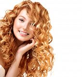 Beauty teenage model girl portrait isolated on white background. Red curly hair. Healthy wavy hair. Hairstyle. Beautiful smiling young woman portrait. Beautiful face, natural make up. Long permed hair poster