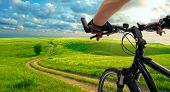 stock photo of bike path  - Man with bicycle riding country road - JPG