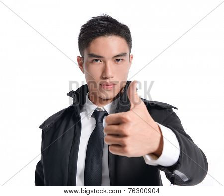Happy businessman with thumbs up gesture,
