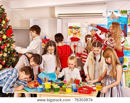 Children making greeting card. Indoor.