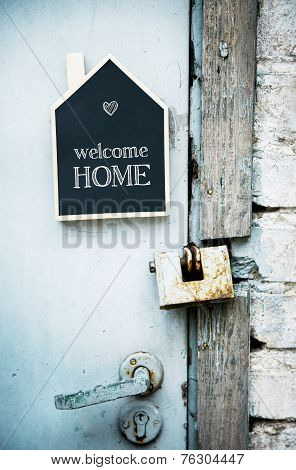 House Shaped Chalkboard Sign On Rustic Blue Door Welcome Home