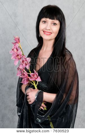 Beautiful Woman   And An Orchid