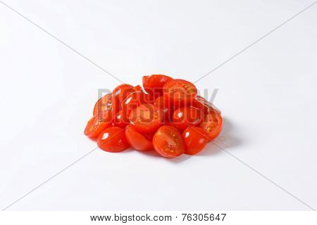 side view of halved cherry tomatoes heap