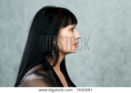 Profile Of The Woman   In A Black Dress