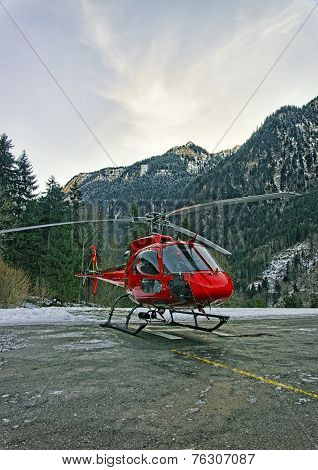 Red Helicopter At Mountain Heliport At Swiss Alps