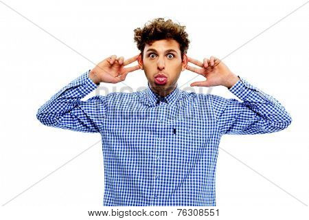 Man sticking out tongue over white background