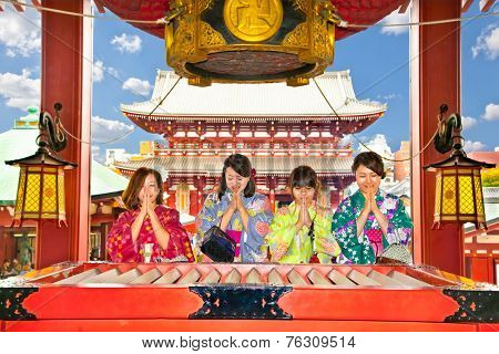 TOKYO, JAPAN - OCT 27, 2014: People pray at Senso-ji Temple in Tokyo,Japan. The Senso-ji Temple is the symbol of Asakusa and one of the most famed temples in Japan.