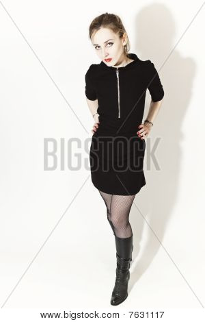 Blond Blue-eyed Woman In Black Dress And Boots
