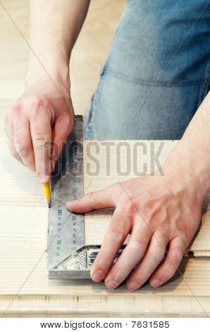 Carpenter Works Using Metal Angle