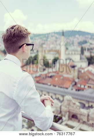 Young business man with overview on Sarajevo city